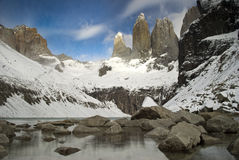 Torres del paine granite peaks at base torres. The torres at base torres under special conditions, covered in snow at national park Torres del Paine, Chile stock image