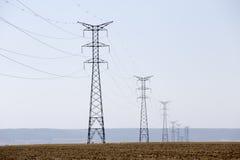 Torres da eletricidade Foto de Stock Royalty Free
