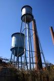 Torres de agua abandonadas del molino Foto de archivo libre de regalías
