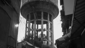 Torres de agua viejas en la vieja parte de minh de Ho Chi