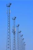 Torres de iluminación con los transmisores del G/M. Imagen de archivo libre de regalías