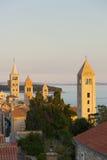 Torres de Rab en la puesta del sol imagenes de archivo
