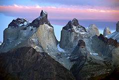 Torres del Paine Mountains, Patagonia Chile. The pink clouds and glaciated mountain tops with snow in Torres del Paine National Park, Chile, at sunrise, in Royalty Free Stock Photo