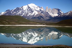 Torres del Paine National Park, Patagonia, Chile. The beautiful reflection of the iconic Torres (towers) and the surrounding mountain ranges. Torres del Paine Stock Photography