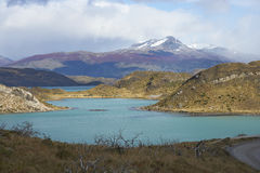 Torres del Paine National Park, Patagonia, Chile. Snow capped peak of Cerro Ferrier (1,600 m) viewed across the blue waters of Lago Pehoe in Torres del Paine Stock Image