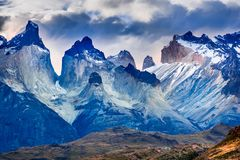 Torres del Paine in Patagonia, Chile - Cuernos del Paine. Torres del Paine, Chile. Cloudy weather austral landscape in Patagonia with Cuernos del Paine in South stock images