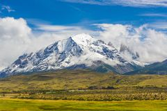 Torres del Paine peaks coming from clouds. Torres del Paine national park, Chile royalty free stock photography