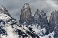 Torres del Paine peaks coming from clouds. Torres del Paine national park, Chile stock photos
