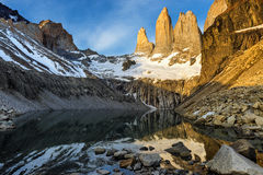 Torres del Paine at sunrise. A view of the Torres del Paine and lake at sunrise Stock Photography