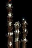 Torres químicas en la noche Imagen de archivo libre de regalías
