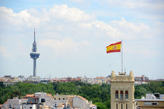 Torrespaña and Flag of Spain Royalty Free Stock Photo