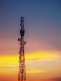 Torretta e tramonto del segnale Fotografie Stock