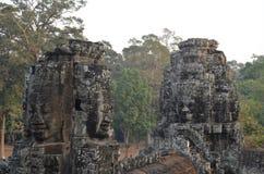 Torrette del fronte in tempiale Angkor Thom di Bayon Immagini Stock