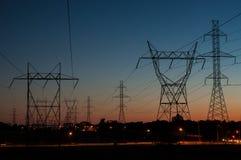 Torrette elettriche al tramonto Immagini Stock