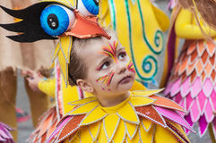 TORREVIEJA, FEBRUARY 19: Carnival groups and costumed characters. Portrait of kid at parade costumed characters,  through the streets of the city. FEBRUARY 19 Stock Photos
