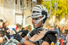 TORREVIEJA, FEBRUARY 19: Carnival groups and costumed characters. Portrait of young girl at costumed characters, parade through the streets of the city. FEBRUARY Royalty Free Stock Photo