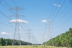 Torri del trasporto di energia Immagine Stock