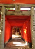 Torri Gateway. A Torri Gateway forms a passage at a Shinto shrine in Fukuoka, Japan Royalty Free Stock Photography