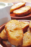 Torrijas, typical spanish dessert for Lent and Easter. Closeup of a plate with some torrijas, typical spanish dessert for Lent and Easter Stock Photos