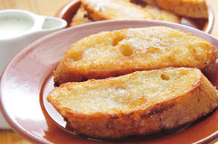 Torrijas, typical spanish dessert for Lent and Easter. Closeup of a plate with torrijas, typical spanish dessert for Lent and Easter Royalty Free Stock Images