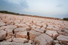 Torrt land i sängen av en torkad flod Fotografering för Bildbyråer