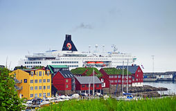 Torshavn, Faroe Islands. June 5, 2014: The ferry ship Norröna from Smyril Line has moored in Torshavn. The ship arrived in the morning from Iceland and was Stock Photo