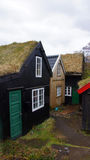 Torshavn with old houses of Tinganes on Faroe Islands. Traditional grass roofed houses of Tinganes on the Faroe Islands Stock Photo