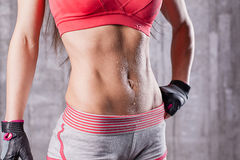 Torso of athlette girl in gym Stock Image