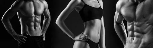 The torso of attractive male and female bodys on black background. Stock Photography