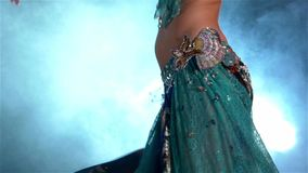 Torso of beautiful young belly dancer, modern, on stock video footage