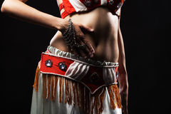 Torso of a Bellydancer. Torso of a female belly dancer, isolated on a black background Royalty Free Stock Image