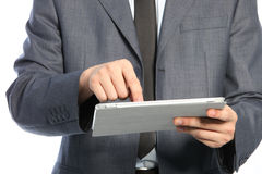 Torso of a businessman using a PC tablet Stock Images