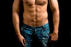 Torso del hombre muscular con el abdomen agradable Imagen de archivo libre de regalías