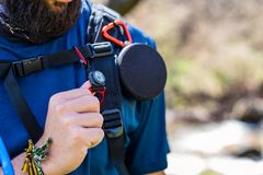 Torso of equipped hiker with speaker, compass and water pipe. Equipped hiker with speaker, compass and water pipe close up stock images