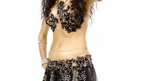 Torso of a exotic female belly dancer, shaking her hips, on white stock video footage