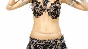 Torso of a exotic female belly dancer who is starting shaking her hips, on white stock video footage
