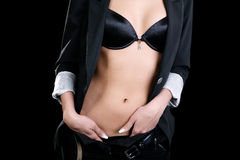 Torso of girl in jacket and bra Stock Photos