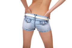 Torso of the girl removing shorts isolated Stock Photo