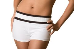 Torso and hips of woman in white shorts bare belly Royalty Free Stock Photo