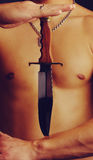Torso and knife Royalty Free Stock Images