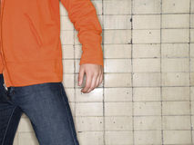 Torso of man against wall. Torso of man against tile wall Stock Photography