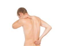 Torso masculino, dolor en la parte posterior imagenes de archivo