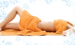 Torso of relaxed lady with orange towels royalty free stock photo