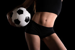 Torso of a sexy woman with a football Stock Images