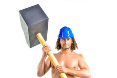 Torso of a shirtless guy holding a sledgehammer Royalty Free Stock Images