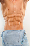 Torso with six-pack. Muscled male torso with jeans Royalty Free Stock Photos