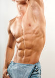 Torso with six-pack. Muscled male torso with jeans Stock Photo