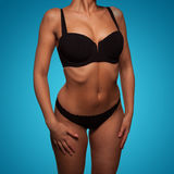 Torso of a slim woman wearing sexy black underwear Royalty Free Stock Photo