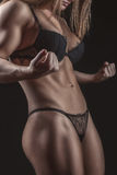 Torso sports girl bodybuilder with big muscles. royalty free stock image