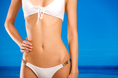Torso of young woman in bikini Royalty Free Stock Images